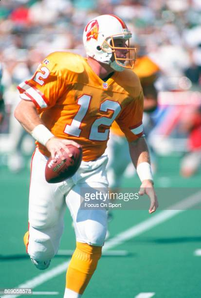 Trent Dilfer of the Tampa Bay Buccaneers runs with the ball against the Philadelphia Eagles during an NFL football game September 3 1995 at Veterans...