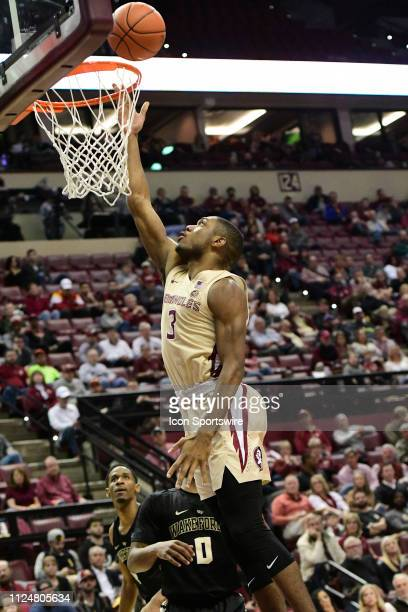 Trent Forrest guard Florida State University Seminoles lays the basketball in the basket for two points Brandon Childress guard Wake Forest...