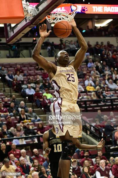 Trent Forrest guard Florida State University Seminoles slams the basketball home for two points over Wake Forest Demon Deacons in an Atlantic Coast...