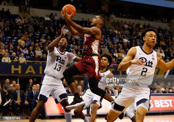 Trent Forrest of the Florida State Seminoles drives to the basket against Khameron Davis and Trey McGowens of the Pittsburgh Panthers at Petersen...