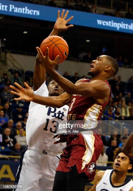 Trent Forrest of the Florida State Seminoles drives to the basket against Khameron Davis of the Pittsburgh Panthers at Petersen Events Center on...