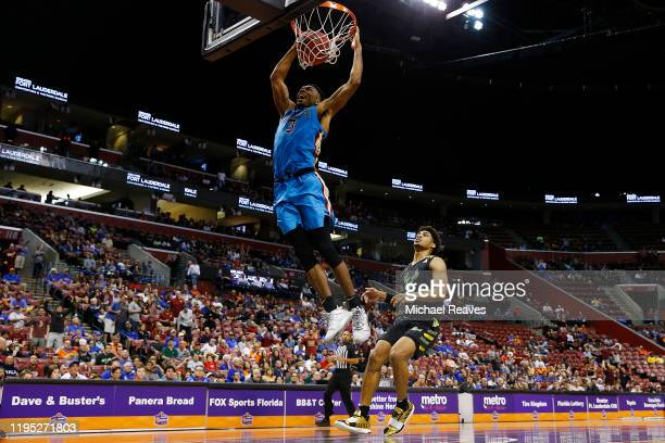 Trent Forrest of the Florida State Seminoles dunks against the South Florida Bulls during the second half of the Orange Bowl Basketball Classic at...