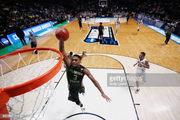 Trent Forrest of the Florida State Seminoles dunks the ball against the Missouri Tigers during the game in the first round of the 2018 NCAA Men's...
