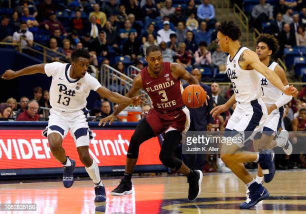 Trent Forrest of the Florida State Seminoles handles the ball against Khameron Davis and Trey McGowens of the Pittsburgh Panthers at Petersen Events...
