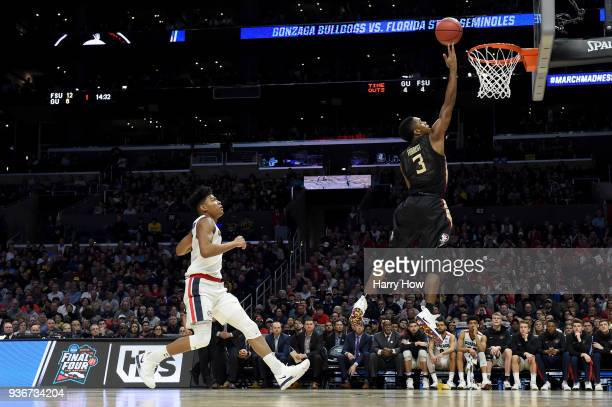 Trent Forrest of the Florida State Seminoles lays the ball up ahead of Rui Hachimura of the Gonzaga Bulldogs in the first half in the 2018 NCAA Men's...