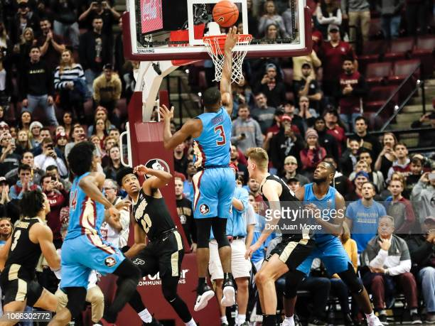 Trent Forrest of the Florida State Seminoles makes the gamewinning jump shots with 52 seconds left in the game against the Purdue Boilermakers during...