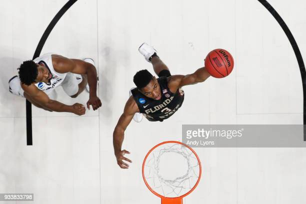 Trent Forrest of the Florida State Seminoles shoots the ball over Quentin Goodin of the Xavier Musketeers during the second half in the second round...