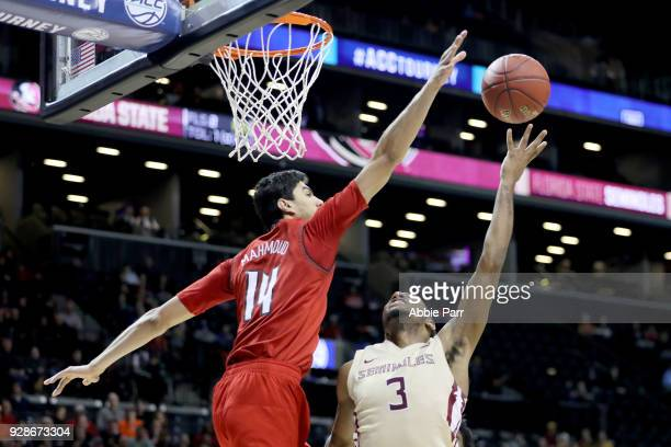 Trent Forrest of the Florida State Seminoles takes a shot against Anas Mahmoud of the Louisville Cardinals in the second half during the second round...