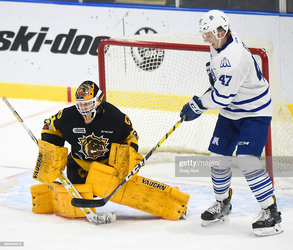 Trent Fox #47 of the Mississauga Steelheads tips a shot on goalie Kaden Fulcher #33 of the Hamilton Bulldogs during game action on December 10, 2017 at Hershey Centre in Mississauga, Ontario, Canada.