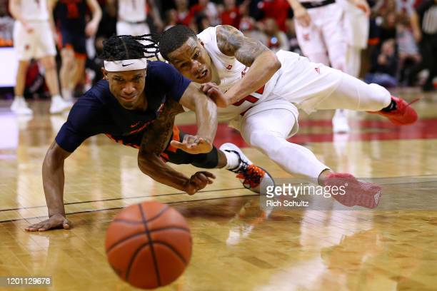Trent Frazier of the Illinois Fighting Illini and Jacob Young of the Rutgers Scarlet Knights dive for a loose ball during the second half of a...