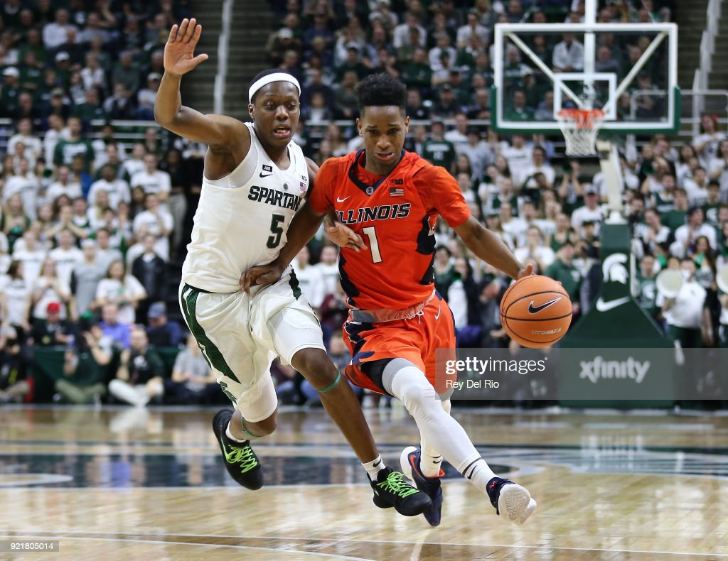 Trent Frazier #1 of the Illinois Fighting Illini drives to the basket while defended by Cassius Winston #5 of the Michigan State Spartans at Breslin Center on February 20, 2018 in East Lansing, Michigan.