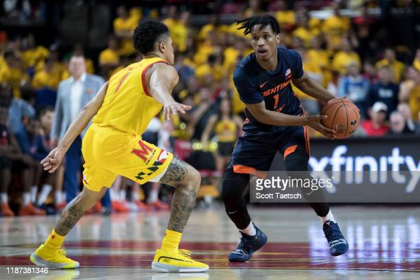 Trent Frazier of the Illinois Fighting Illini handles the ball against Anthony Cowan Jr #1 of the Maryland Terrapins during the first half at Xfinity...
