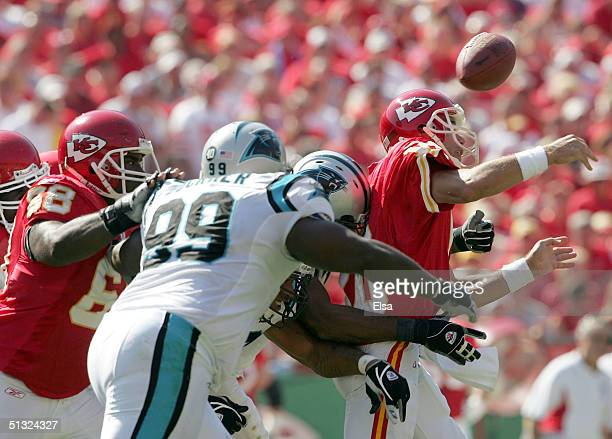 Trent Green of the Kansas City Chiefs is hit by Michael Rucker and Brentson Buckner of the Carolina Panthers at Arrowhead Stadium on September 19...