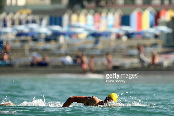 Trent Grimsey of Australia swims in the Men's 25 Km Open Water Swimming during the 13th FINA World Championships at Ostia Beach on July 25, 2009 in...