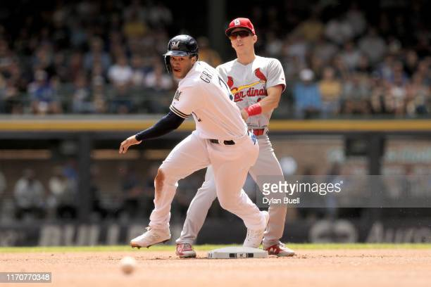 Trent Grisham of the Milwaukee Brewers runs to second base past Tommy Edman of the St. Louis Cardinals in the first inning at Miller Park on August...