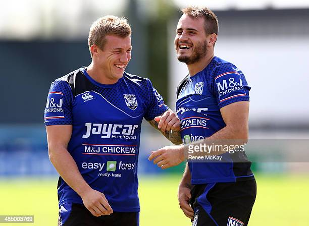 Trent Hodkinson and Josh Reynolds joke around during a Canterbury Bulldogs NRL training session at Belmore Oval on April 16 2014 in Sydney Australia