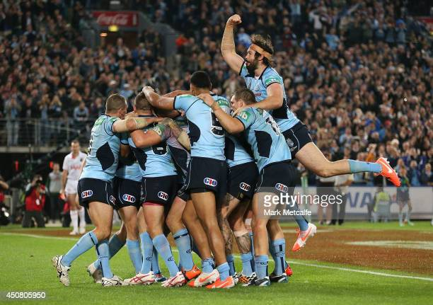 Trent Hodkinson of the Blues celebrates scoring a try with team mates during game two of the State of Origin series between the New South Wales Blues...