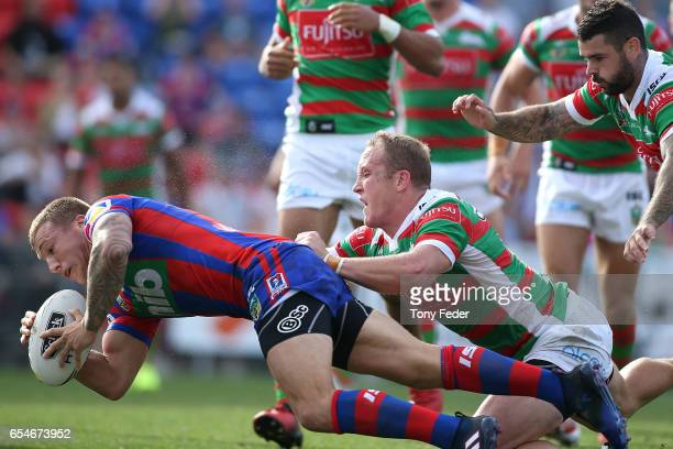 Trent Hodkinson of the Knights scores a try during the round three NRL match between the Newcastle Knights and the South Sydney Rabbitohs at McDonald...