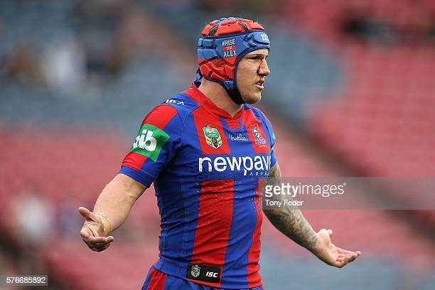 Trent Hodkinson of the Knights wears a helmet during the round 19 NRL match between the Newcastle Knights and the Melbourne Storm at Hunter Stadium...