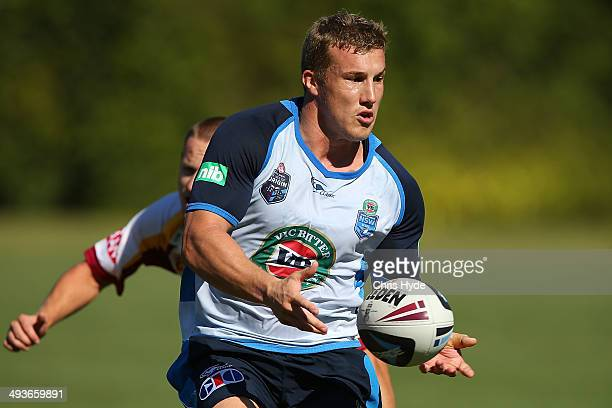 Trent Hodkinson passes during an opposed session against North Coast group 3 team during the New South Wales Blues State of Origin training session...