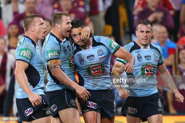 Trent Hodkinson Trent Merrin Jarryd Hayne and Josh Reynolds of the Blues celebrate after winning game one of the State of Origin series between the...