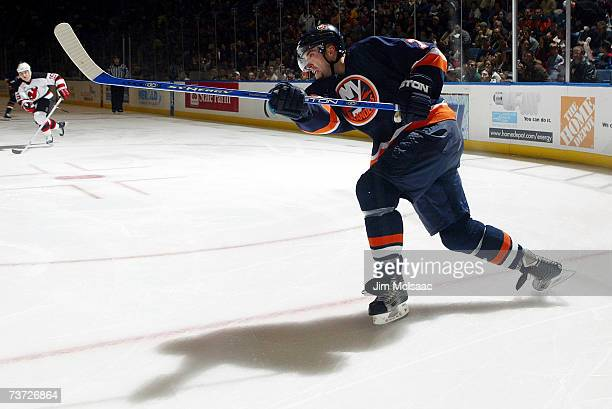 Trent Hunter of the New York Islanders shoots the puck against the New Jersey Devils during their game on March 27, 2007 at Nassau Coliseum in...