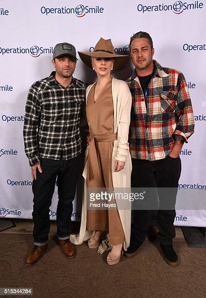 Trent Kinney Lady Gaga and Taylor Kinney pose at Tupelo on March 12 2016 in Park City Utah