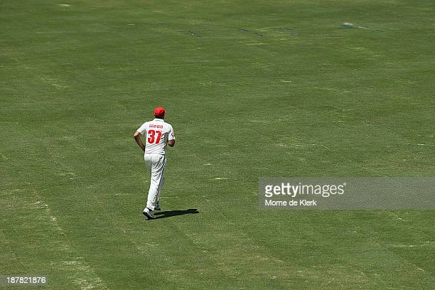 Trent Lawford of the Redbacks runs over the recently laid grass during day one of the Sheffield Shield match between the Redbacks and the Warriors at...