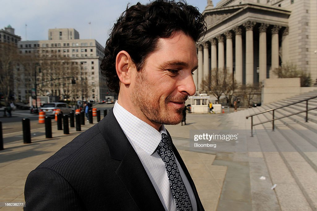 Trent Martin, a former financial analyst at Nomura Holdings Inc., enters federal court in New York, U.S., on Wednesday, April 10, 2013. Prosecutors say Martin used inside tips about International Business Machines Corp.'s $1.2 billion acquisition of SPSS Inc. to profit on trades. Photographer: Peter Foley/Bloomberg via Getty Images