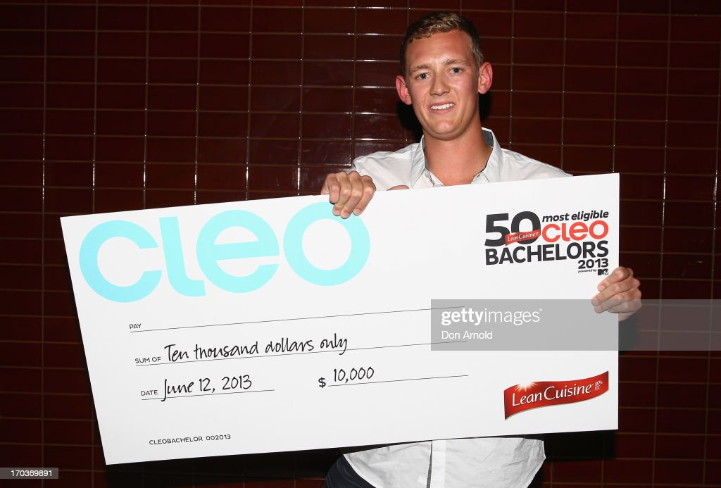 Trent Maxwell poses with his cheque for winning the top award this year at the CLEO Bachelor of the Year Awards at the Beresford Hotel on June 12, 2013 in Sydney, Australia.