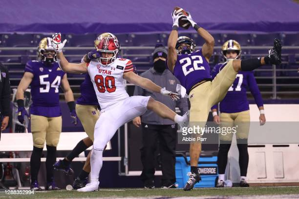 Trent McDuffie of the Washington Huskies intercepts a pass during the final seconds of play to secure a 24-21 win against the Utah Utes at Husky...