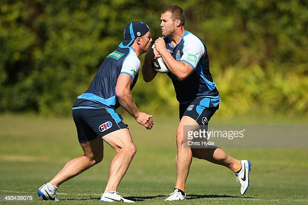Trent Merrin is tackled by Beau Scott during a New South Wales Blues State of Origin training session on May 24 2014 in Coffs Harbour Australia