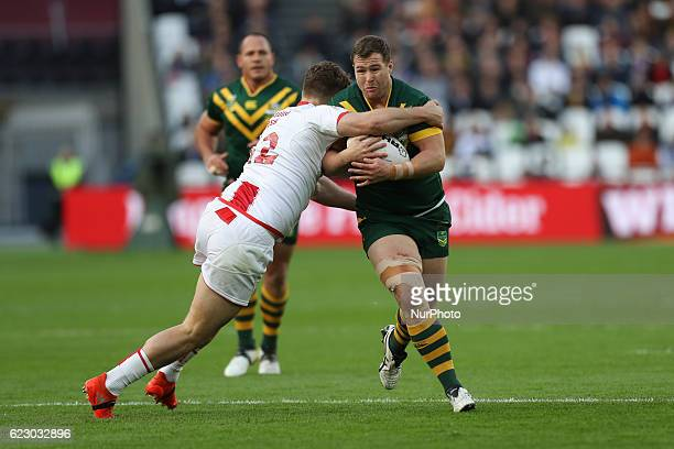 Trent Merrin of Australia charges through Elliot Whitehead of England during the Four Nations between England against Australia at The London Stadium...