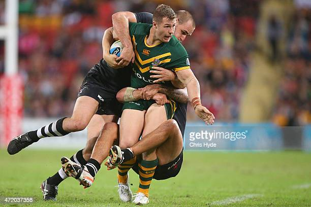 Trent Merrin of Austrlalia is tackled by Kevin Proctor of New Zealand during the TransTasman Test match between the Australia Kangaroos and the New...