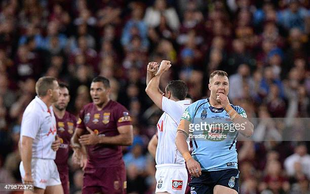 Trent Merrin of the Blues is put on report for an illegal tackle by referee Gerard Sutton during game three of the State of Origin series between the...