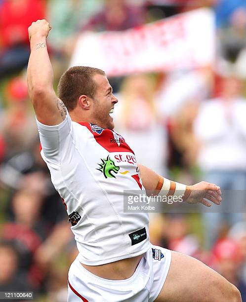 Trent Merrin of the Dragons celebrates scoring a try during the round 23 NRL match between the St George Illawarra Dragons and the Sydney Roosters at...