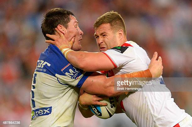 Trent Merrin of the Dragons is tackled during the NRL Elimination Final match between the Canterbury Bulldogs and the St George Illawarra Dragons at...