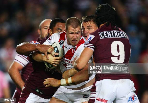 Trent Merrin of the Dragons is tackled during the round 13 NRL match between the Manly Warringah Sea Eagles and the St George Illawarra Dragons at...