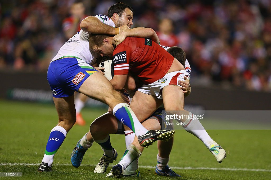 Trent Merrin of the Dragons is tackled during the round 20 match between the St George Illawarra Dragons and the Canberra Raiders at WIN Stadium on July 27, 2013 in Wollongong, Australia.