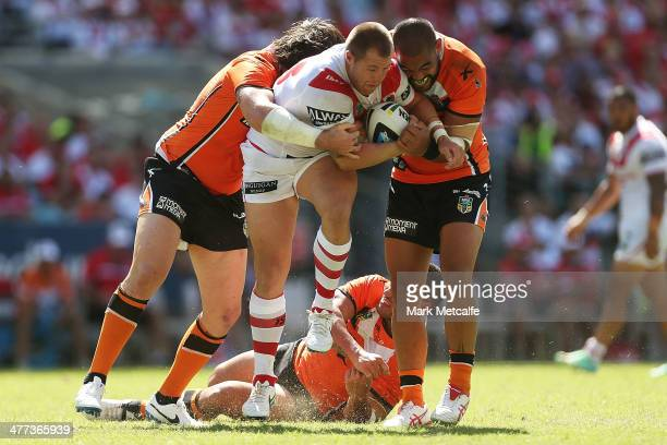 Trent Merrin of the Dragons is tackled during the round one NRL match between the St George Illawarra Dragons and the Wests Tigers at ANZ Stadium on...