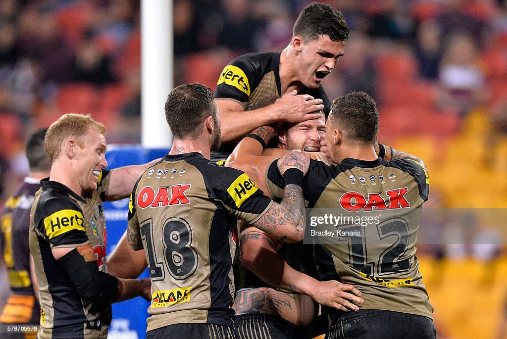 Trent Merrin of the Panthers is congratulated by team mates after scoring a try during the round 20 NRL match between the Brisbane Broncos and the Penrith Panthers at Suncorp Stadium on July 22, 2016 in Brisbane, Australia.