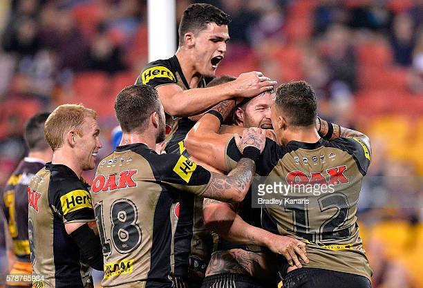 Trent Merrin of the Panthers is congratulated by team mates after scoring a try during the round 20 NRL match between the Brisbane Broncos and the...