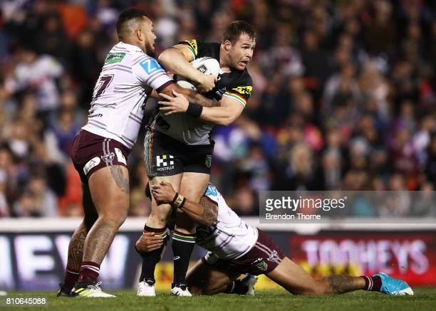 Trent Merrin of the Panthers is tackled by Addin FonuaBlake of the Sea Eagles during the round 18 NRL match between the Penrith Panthers and the...