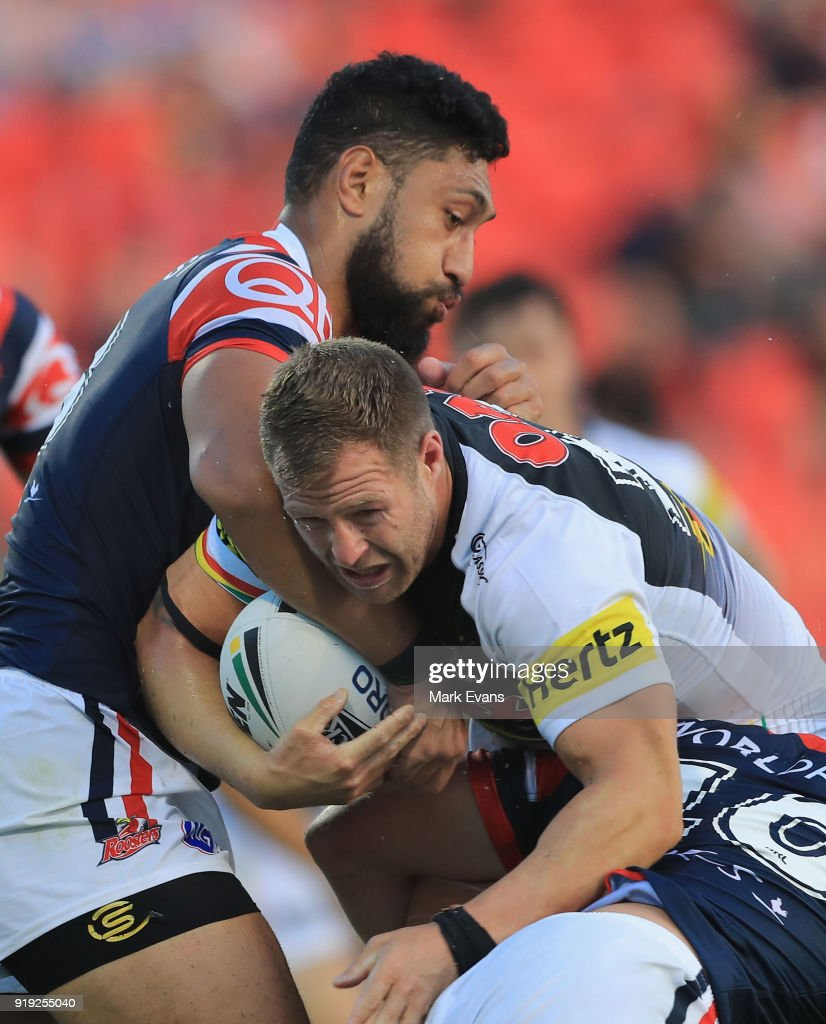 Trent Merrin of the Panthers (R) is tackled by Isaac Liu of the Roosters during the NRL trial match between the Penrith Panthers and the Sydney Roosters at Penrith Stadium on February 17, 2018 in Sydney, Australia.