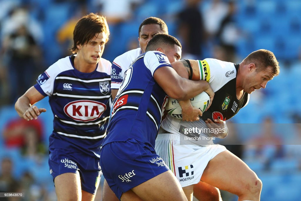 Trent Merrin of the Panthers is tackled by the Bulldogs defence during the NRL trial match between the Penrith Panthers ands the Canterbury Bulldogs at Belmore Sports Ground on February 24, 2018 in Sydney, Australia.