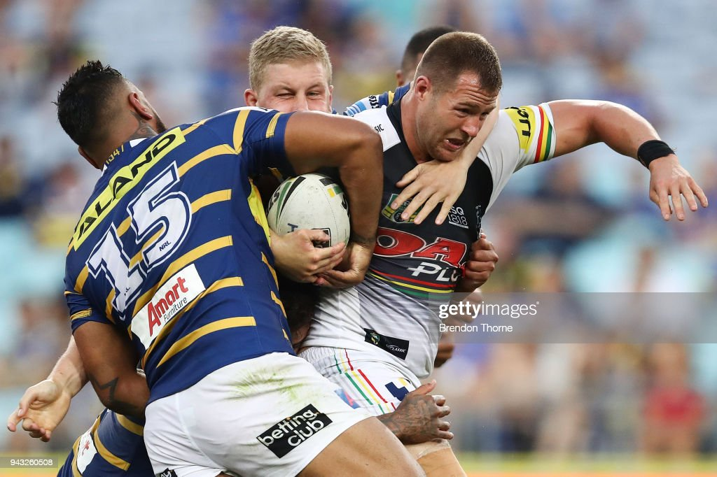 Trent Merrin of the Panthers is tackled by the Eels defence during the round five NRL match between the Parramatta Eels and the Penrith Panthers at ANZ Stadium on April 8, 2018 in Sydney, Australia.