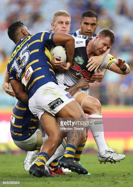 Trent Merrin of the Panthers is tackled by the Eels defence during the round five NRL match between the Parramatta Eels and the Penrith Panthers at...