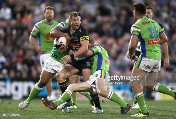 Trent Merrin of the Panthers is tackled during the round 21 NRL match between the Penrith Panthers and the Canberra Raiders at Panthers Stadium on...
