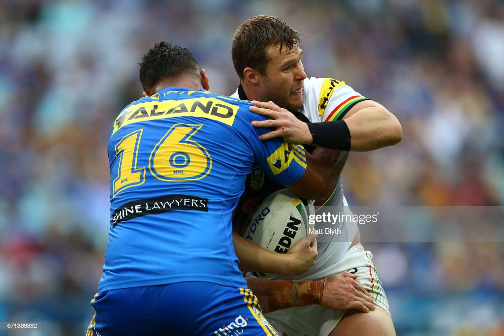 Trent Merrin of the Panthers is tackled during the round eight NRL match between the Parramatta Eels and the Penrith Panthers at ANZ Stadium on April 22, 2017 in Sydney, Australia.