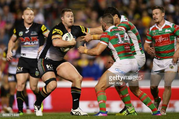 Trent Merrin of the Panthers is tackled during the round six NRL match between the Penrith Panthers and the South Sydney Rabbitohs at Pepper Stadium...